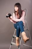 Young woman with video camera Royalty Free Stock Photos