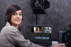 Young woman video editor working in studio royalty free stock photos