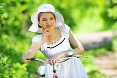 Young woman with a vintage bicycle Royalty Free Stock Photo