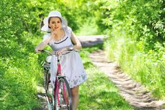 Young woman with a vintage bicycle Royalty Free Stock Images