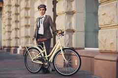 Young woman at vintage bicycle british style Royalty Free Stock Photo