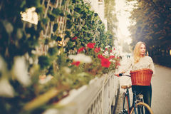 Young woman on a vintage bicycle in the city Royalty Free Stock Photos