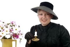 Young woman in vintage costume 1900s with candle Stock Photos