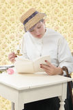 Young woman in  vintage costume 1900s read a book Stock Photography