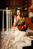 Young woman in vintage dress on autumn porch. Beauty girl in fa. Young beautiful woman in vintage dress on autumn porch. Beauty girl in fall orange leaves stock images