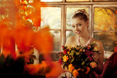 Young woman in vintage dress on autumn porch. Beauty girl in fa. Young beautiful woman in vintage dress on autumn porch. Beauty girl in fall orange leaves stock photos