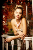 Young woman in vintage dress on autumn porch. Beauty  girl in fa Stock Photography