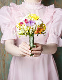 Young woman in vintage dress holding bouquet of flowers, Royalty Free Stock Images