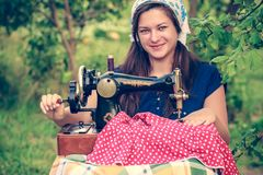 Young woman with vintage hand sewing machine Stock Image