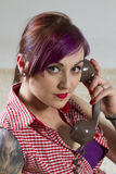Young woman in a vintage look with telephone Royalty Free Stock Photography