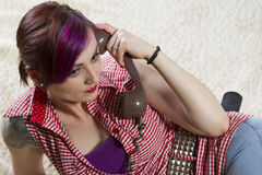 Young woman in a vintage look with telephone Royalty Free Stock Photo