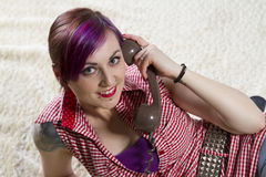 Young woman in a vintage look with telephone Stock Photo