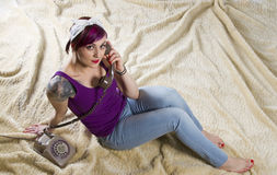 Young woman in a vintage look with telephone Stock Photography
