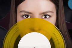 Young woman with vinyl disc Royalty Free Stock Images
