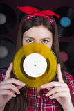 Young woman with vinyl disc Stock Photography