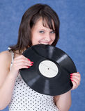 Young woman and vinyl record Royalty Free Stock Photo