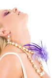 Young woman with violet feather Royalty Free Stock Photos