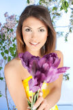 young woman with a violet tulip flower Stock Image