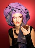 Young woman in violet turban Royalty Free Stock Photography