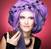 Young woman in violet turban Royalty Free Stock Images