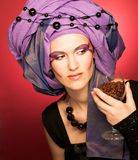Young woman in violet turban Stock Photos