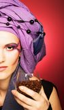 Young woman in violet turban Stock Image