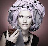 Young woman in violet turban Royalty Free Stock Image