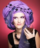 Young woman in violet turban Stock Images