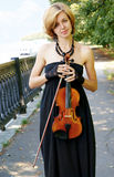 Young woman with violin Royalty Free Stock Photography