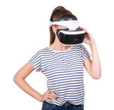 A young woman in a virtual glasses, isolated on a white background. Video game simulation, 3d vision technology. Royalty Free Stock Image