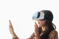 Young woman with virtual reality glasses. Modern technologies. The concept of future technology. Young woman with virtual reality glasses. The concept of future Stock Photo
