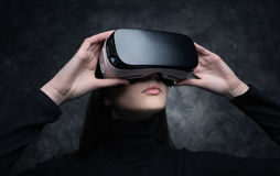 Young woman with virtual reality headset. Young beautiful woman wearing a VR headset and experiencing virtual reality Stock Photos