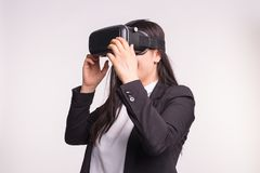 Young woman with virtual reality helmet on white background.  stock photo