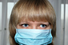 Young woman with virus protection mask Royalty Free Stock Images