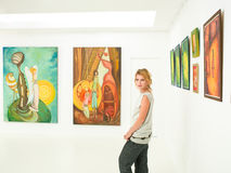 Young woman visiting art exhibition Royalty Free Stock Photography