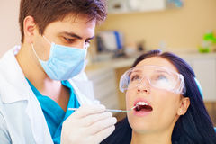 Young woman visiting dentist in clinic Stock Photography