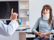 Young woman visiting doctor for medical examination stock image