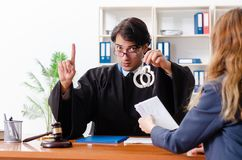 The young woman visiting male lawyer stock photo