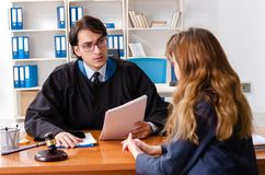 The young woman visiting male lawyer. Young women visiting male lawyer stock photography
