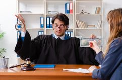 The young woman visiting male lawyer. Young women visiting male lawyer royalty free stock images