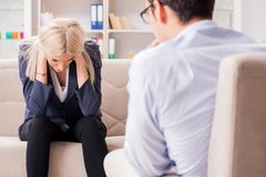 The young woman visiting psychiatrist man doctor for consultation. Young women visiting psychiatrist men doctor for consultation Stock Photo