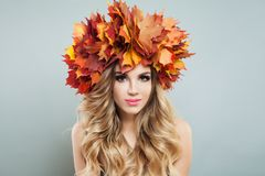 Young woman with vivid fall leaves. Autumn beauty.  royalty free stock photography