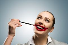Young woman with vivid red mouth Stock Photos