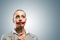 Young woman with vivid red mouth Royalty Free Stock Image