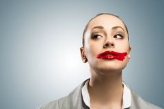 Young woman with vivid red mouth Stock Images