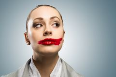 Young woman with vivid red mouth Stock Image
