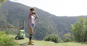 Young woman in VR glasses among mountains stock video