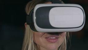 Young woman with vr glasses watching movie stock video footage