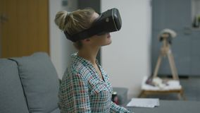 Young woman in VR headset stock video footage