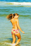 Young Woman Wading on Water. Royalty Free Stock Photography